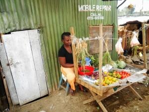Selling vegetables.